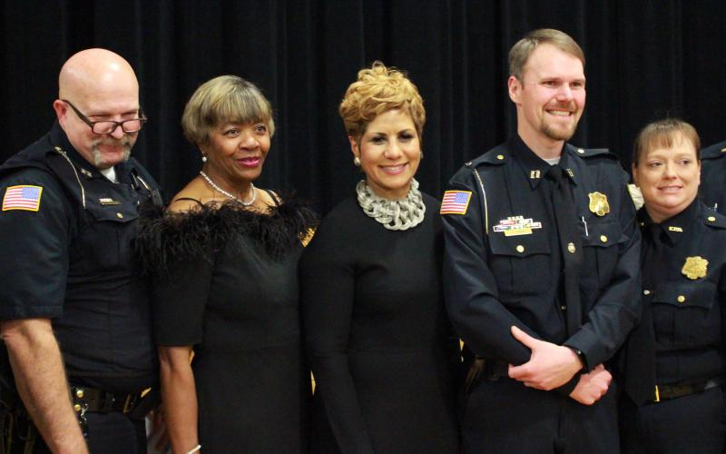 Posing with MLK Committee Founding Chair Mary Clark and Keynote Speaker Justine Norman Boyd were members of the Elberton Police Department: (L-R) Captain John Curlee, Clark, Boyd, Captain Joseph David and Elberton Police Department Office Manager Christy David. (Photo by Scoggins)
