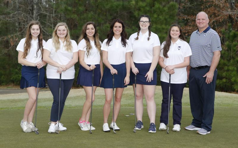 The 2020 Lady Blue Devil golfers are (L-R) Elizabeth Brady, Emaleigh Oglesby, Madison Webb, Eliza Banks, Ava Dye, Abby Bryant and coach Bruce Brown. (Photo by Cary Best)
