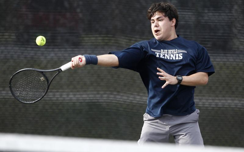 Blue Devil No. 1 singles player Kody Alcantar beat Purple Hurricane Conner Bradley 6-4, 6-1 during Elbert County's region-opener win over Monticello at the B.F. Coggins Tennis Complex in McWilliams Park in Elberton. (Photo by Cary Best)