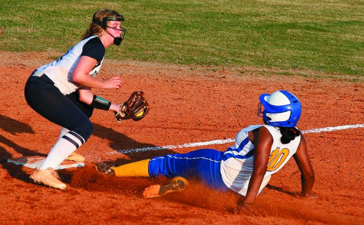 Lady Blue Devil junior infielder Ellie Jourolmon (left) tags out Lady Tiger Kariah Smith during Elbert County's 10-8 victory over Washington-Wilkes Aug. 6 on King Field in Elberton. (Photo by Cary Best)