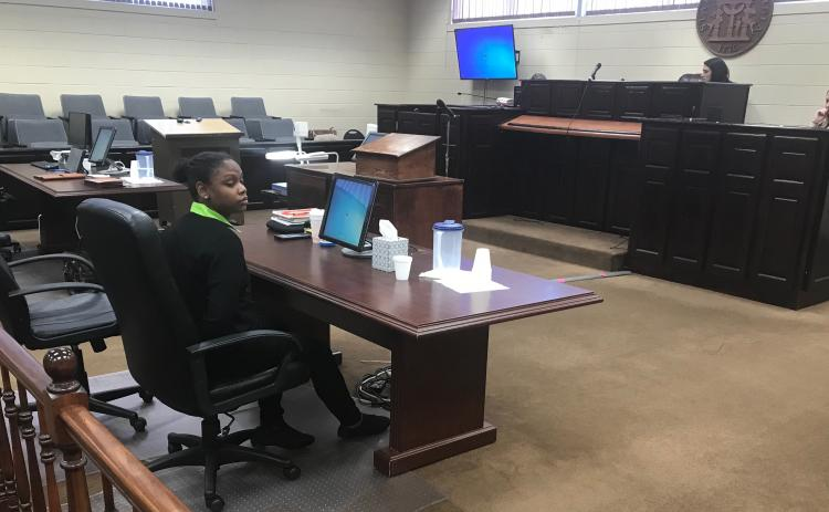 Savanna Marrie Jennings sits alone, handcuffed by Scott Franklin of the Elbert County Sheriff's Office, shortly after a jury convicted her on seven charges, including malice murder and felony murder, in the death of Otha Perrin in 2018. She was also found guilty on two counts of aggravated assault, two counts of possession of a firearm or knife in the commission of a felony and concealing the death of another. (Photo by Jones)