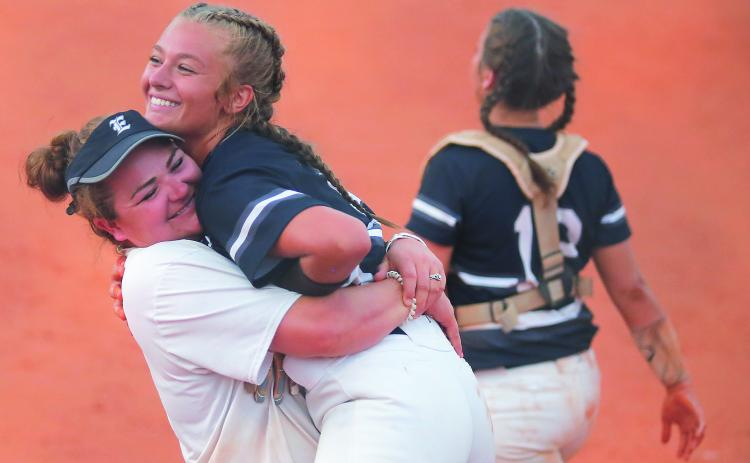 Lady Blue Devil assistant coach Katie Archer (left) and senior pitcher Lauren Hart react during Elbert County's 11-1 victory at Clarke Central High School  Sept. 4 in Athens (Photo by Cary Best)