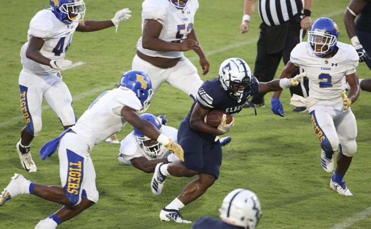 Blue Devil senior running back Shun Allen alludes Tiger defenders on his way to a 134-yard, two-touchdown performance during Elbert County's 28-14 victory over Washington-Wilkes Aug. 30 in Elberton. (Photo by Dan Giles)