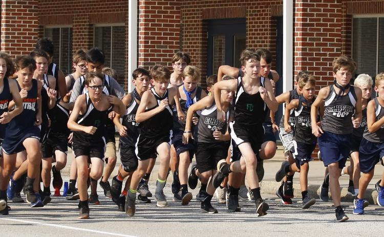 Rams runners (L-R) Mason Dove, Aiden Belli, Kale Kurtz, Brayden Ingram, Eli Harris, Sam Gailey, Madden Drake take off from the starting line in the first Elbert County Middle School Cross County meet Sept. 10. (Photo by Cary Best)