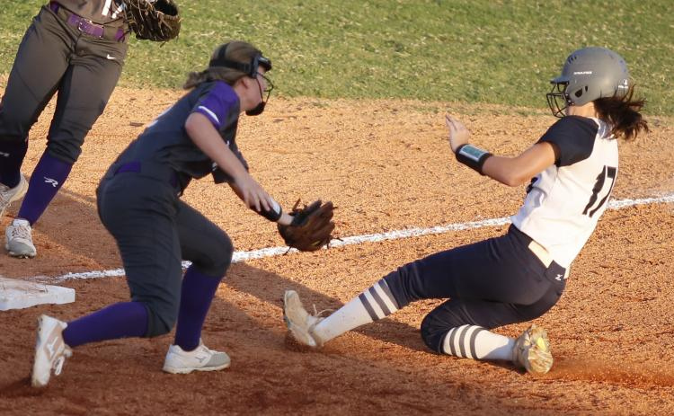 ady Blue Devil junior Madelyn Diaz (left) slides safely into third base during the sixth inning of Elbert County's 2-1 loss to Union County Aug. 28 at King Field in Elberton. (Photo by Cary Best)