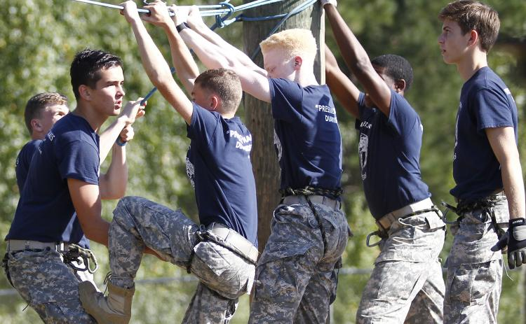 Elbert County JROTC Male Raiders team members (L-R) Logan Vickery, Briley Jenkins, Grady Thomas, Jordan Teasley, D.J. Veal and Nicholas Smith compete in the rope bridge event during a meet at Jackson County High School Sept. 21 in Jefferson. (Photo by Cary Best)