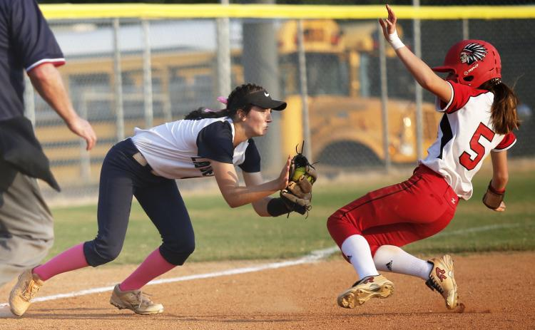 Junior Lady Diamond Madelyn Dias (left) tags Lady Redskin Cara Mayfield in the fifth inning of Elbert County's 3-2 Region 8-AA win over Social Circle Sept. 12 on King Field in Elberton. (Photo by Cary Best)
