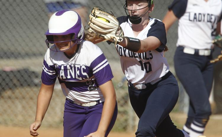 Lady Diamond Devil freshman shortstop Lilly Ray (right) tags out Lady Purple Hurricane Azure Guli during the first game of a region tournament doubleheader with Monticello Sept. 25 on King Field in Elberton. (Photo by Cary Best)