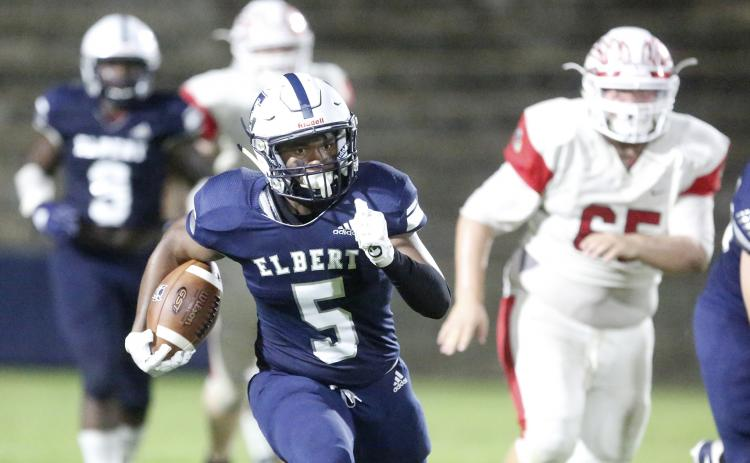 Blue Devil junior running back C.J. Tate rushes for an 80-yard touchdown during Elbert County's 56-7 region win over Social Circle Friday night Sept. 27 in the Granite Bowl in Elberton (Photo by Cary Best).