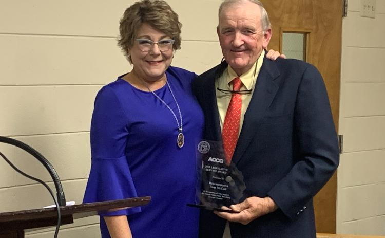Representative Tom McCall received the 2019 Legislative Service Award from Debra Nesbit from the ACCG at the BOC meeting Oct. 16 (Photo by Scoggins).
