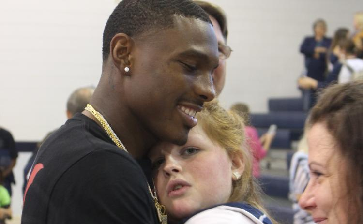 Kansas City Chiefs wide receiver Mecole Hardman surprised everyone by showing up at Elbert County Middle School Friday after a Thursday night NFL game in Denver. Among the many who got to greet Mecole was Marti Love Terrell.  Hardman also participated in a Friends Helping Friends basketball game. (Photo by Scoggins)