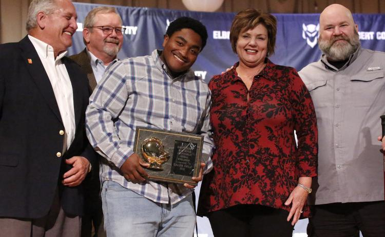 Blue Devil senior Caleb Hale (center) reacts as he accepts the 2019 L.C. Piccirillo Scholarship and Football Award during the Elbert County Athletic Department's Fall Sports Awards Program Monday night Dec. 9 in the Elbert County Middle School Auditorium. Pictured with Hale (L-R) are Ciro Piccirillo, Ed Fendley, Nannette Piccirillo and Lenny Piccirillo. (Photo by Cary Best)