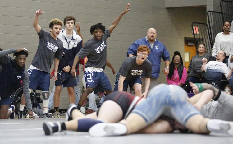 Mat Devils (L-R) Jamal Rucker, Alberto Cervantes, Jake Keblish, Tyshawn Hughes and Marty Bailey react to senior Brice Noggle getting a pin during Elbert County's 34-27 win over Oglethorpe County during the Area 6-AA Dual semi-finals Jan. 11 at Jasper County High School in Monticello. (Photo by Cary Best)