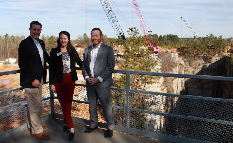 EGA Executive Vice President Chris Kubas, Elbert County Chamber of Commerce President Leslie Friedman and BOC Chairman Lee Vaughn stand on the viewing platform over Pyramid Quarry on Monday, Feb. 3.