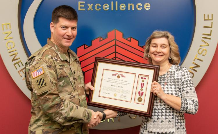 Vicky Stanley was presented the Meritorious Civilian Service Award by Col. Marvin Griffin, Commander, U.S. Army Engineering and Support Center on Jan. 13 in Huntsville, Alabama.