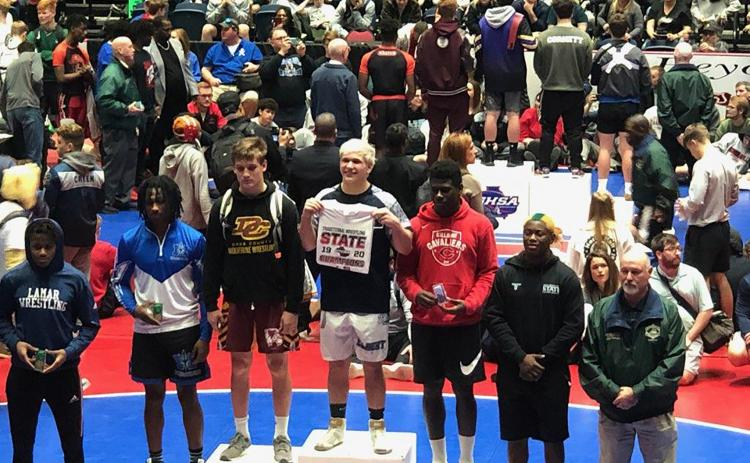 Mat Devil senior Brice Noggle (center) won the 182-pound state title during the Georgia High School Association's 2020 State Traditional Wrestling Championships Feb. 13-15 in Macon.