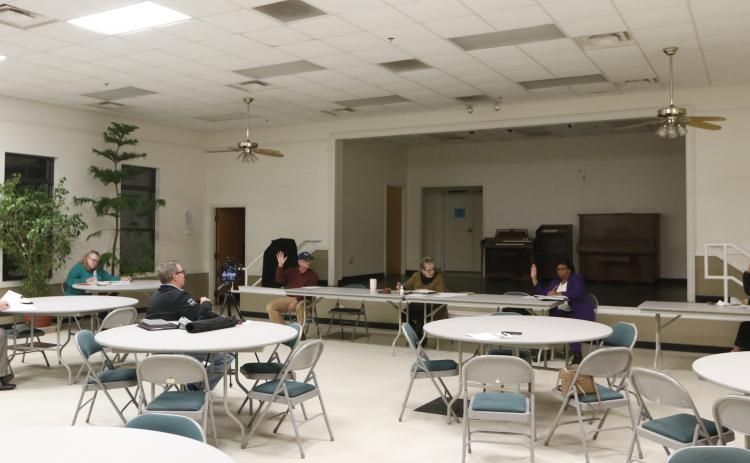 The Bowman council practiced 'social distancing' at its meeting at the Bowman Community Center Monday night. (Photo by Scoggins)