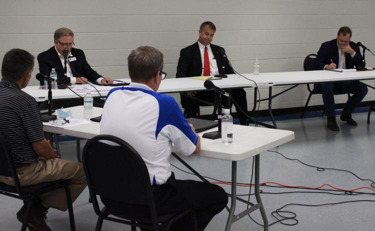 Elberton Star Publisher Gary Jones (L) and WSGC Radio's Linton Johnson (R) in the foreground asked Georgia House Rep. District 33 candidates questions at last week's forum at the county government complex – the candidates are (L-R) Bruce Azevedo of Madison County, Rob Leverett of Elbert County and Tripp  Strickland of Madison County. (Photo by Scoggins)