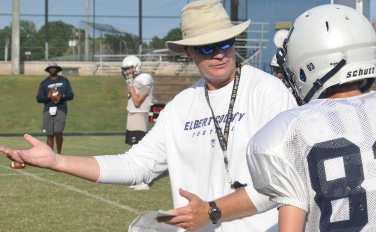 "Coach Shannon Jarvis works with wide receivers in a ""shell"" practice with shoulder pads and helmets on Wednesday, Aug. 5. Elbert County's scrimmage at Franklin County on Friday, Aug. 21  was eliminated by the Georgia High School Association. (Photo by Jones)"