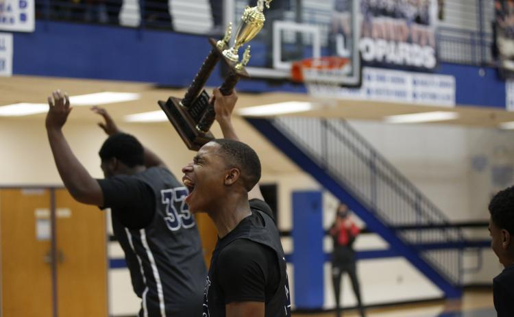 Blue Devil Jamil Burton celebrates the Devils' Region Championship win at Banks County High School Thursday, Feb. 18. (Photo by Scoggins)