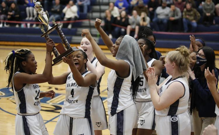 Lady Devils Jamia and Jameria Allen, Lilly Ray and Brenasia Faust celebrate the Lady Devils' Region Championship win at Banks County High School Thursday, Feb. 18. (Photo by Scoggins)